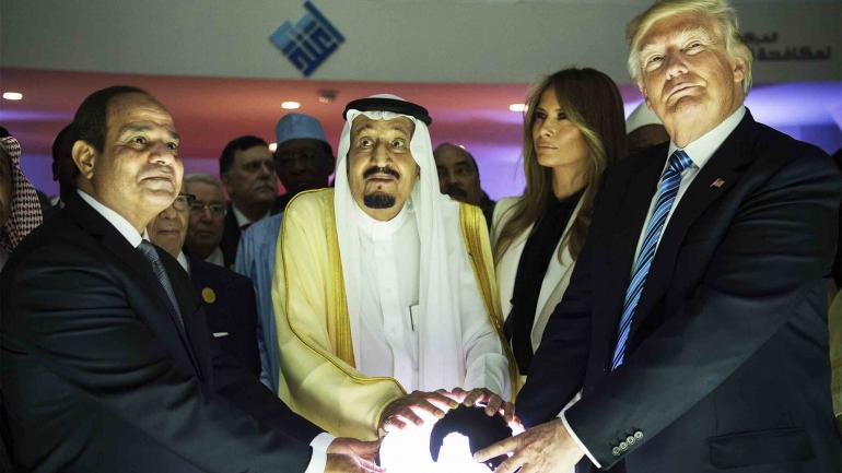 """RIYADH, SAUDI ARABIA - MAY 21: (----EDITORIAL USE ONLY MANDATORY CREDIT - """"BANDAR ALGALOUD / SAUDI ROYAL COUNCIL / HANDOUT"""" - NO MARKETING NO ADVERTISING CAMPAIGNS - DISTRIBUTED AS A SERVICE TO CLIENTS----)US President Donald Trump, US First lady Melania Trump (2nd R), Saudi Arabia's King Salman bin Abdulaziz al-Saud (2nd L) and Egyptian President Abdel Fattah el-Sisi (L) put their hands on an illuminated globe during the inauguration ceremony of the Global Center for Combating Extremist Ideology in Riyadh, Saudi Arabia on May 21, 2017. (Photo by Bandar Algaloud / Saudi Royal Council / Handout/Anadolu Agency/Getty Images)"""