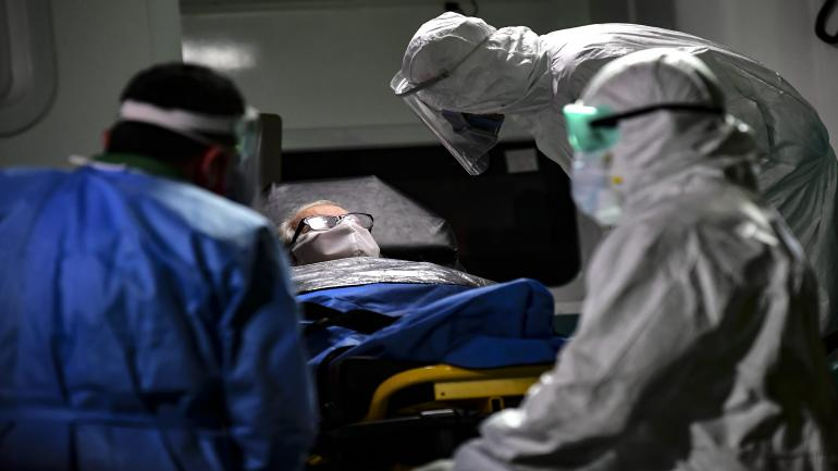 An elderly man with symptoms of the new coronavirus is carried into an ambulance to be transferred from the Carpe Diem nursing home to a hospital in Buenos Aires on May 7, 2020. (Photo by RONALDO SCHEMIDT / AFP)