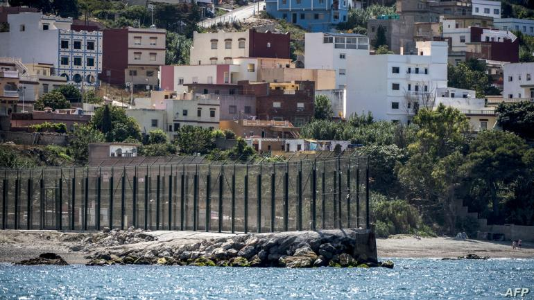 A picture taken on September 4, 2018 shows a view of a section of the border fence encircling Spain's North African enclave of Ceuta which lies on the Strait of Gibraltar, surrounded by Morocco. (Photo by FADEL SENNA / AFP)