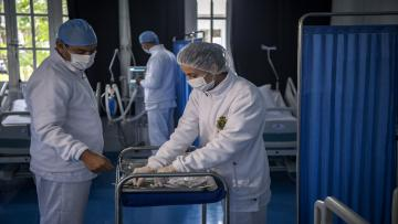Members of the medical staff at Moroccos's military field hospital in Nouaceur, South of Casablanca, check on equipment on April 18, 2020 as they prepare to receive patients of the coronavirus pandemic. - Military hospitals have been reordered to maximise bed capacity, he said, adding that two field hospitals had been deployed to the coastal Casablanca region. Morocco had recorded 2,670 confirmed cases of coronavirus and 137 deaths, while over 280 have officially recovered. The North African kingdom has closed its borders and imposed a lockdown, enforced by security forces, to stem the spread of the disease. (Photo by FADEL SENNA / AFP) (Photo by FADEL SENNA/AFP via Getty Images)