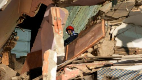 A member of the rescue teams searches for people trapped under the rubble after a four-storey building collapsed in Casablanca on August 5, 2016. Witnesses said the building that collapsed in the Sbata district of Morocco's economic capital had a cafe on the ground floor that had been teeming with clients at the time of the accident. / AFP / FADEL SENNA (Photo credit should read FADEL SENNA/AFP via Getty Images)