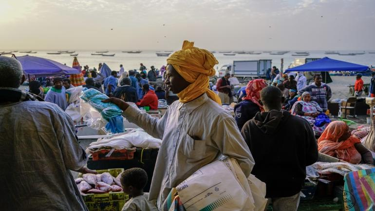 NOUAKCHOTT, MAURITANIA - DECEMBER 31: A plastic bag seller hawks his illegal wares at the fish market of Nouakchott, Mauritania. Mauritania outlawed plastic bags for environmental reasons but the bags are still popular for other reasons. (David Degner/Getty Images)