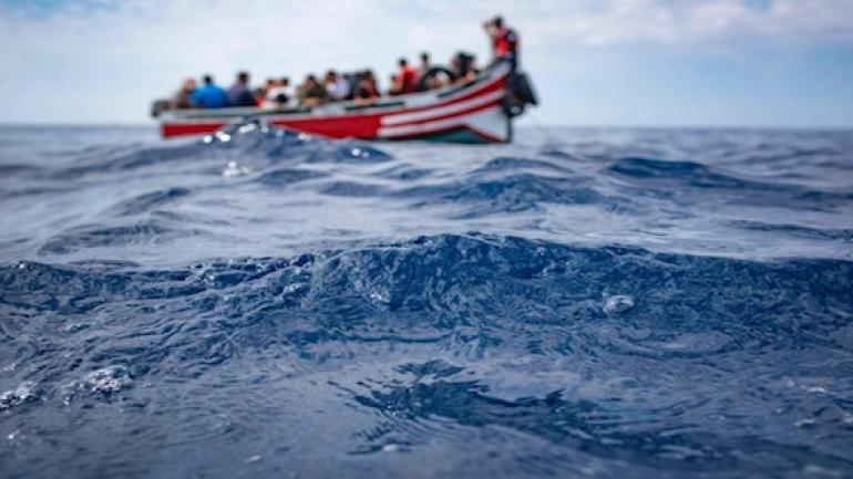 TOPSHOT - A boat carrying 157 migrants is stranded in the Strait of Gibraltar before being rescued by the Spanish Guardia Civil and the Salvamento Maritimo sea search and rescue agency on September 8, 2018. - While the overall number of migrants reaching Europe by sea is down from a peak in 2015, Spain has seen a steady increase in arrivals this year and has overtaken Italy as the preferred destination for people desperate to reach the continent. Over 33,000 migrants have arrived in Spain by sea and land so far this year, and 329 have died in the attempt, according to the International Organization for Migration. (Photo by Marcos Moreno / AFP)