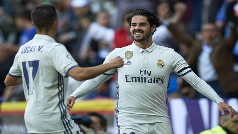 MADRID, SPAIN - APRIL 02: Isco (R) of Real Madrid celebrates with Lucas Vazquez of Real Madrid after scoring a goal during the La Liga match between Real Madrid and Deportivo Alaves at Estadio Santiago Bernabeu on April 2, 2017 in Madrid, Spain. (Photo by fotopress/Getty Images)