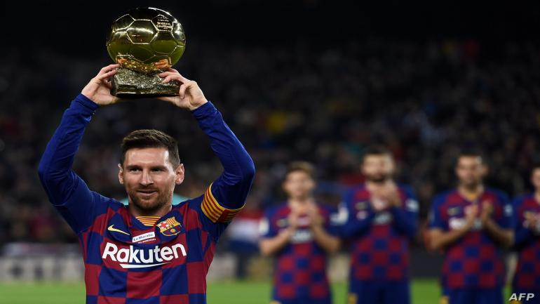 Barcelona's Argentine forward Lionel Messi poses with his sixth Ballon d'Or before the Spanish League football match between FC Barcelona and RCD Mallorca at the Camp Nou stadium in Barcelona on December 7, 2019. (Photo by Josep LAGO / AFP)