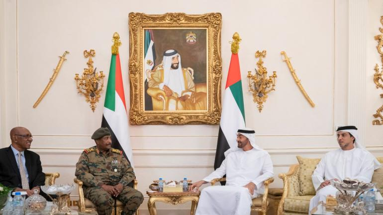 ABU DHABI, UNITED ARAB EMIRATES - May 26, 2019: HH Sheikh Mohamed bin Zayed Al Nahyan, Crown Prince of Abu Dhabi and Deputy Supreme Commander of the UAE Armed Forces (2nd R) meets with Lieutenant General Abdel Fattah Al Burhan Abdelrahman, Head of transitional military council of Sudan (2nd L), at the Presidential Airport. Seen with HH Sheikh Mansour bin Zayed Al Nahyan, UAE Deputy Prime Minister and Minister of Presidential Affairs (R). ( Mohamed Al Hammadi / Ministry of Presidential Affairs ) ---