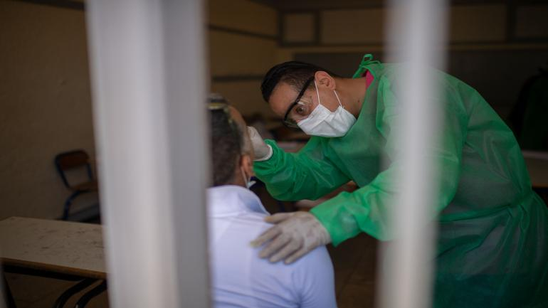 RABAT, MOROCCO - MAY 28: A medical worker takes a swab sample from a taxi driver as part of the novel coronavirus (COVID-19) testing at Moulay Abdellah Hospital in Morocco's capital Rabat on May 28, 2020. (Photo by Jalal Morchidi/Anadolu Agency via Getty Images)