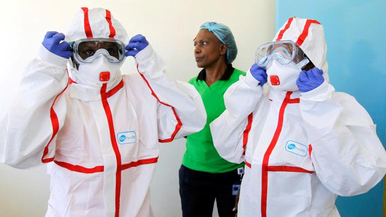 Kenyan nurses wear protective gear during a demonstration of preparations for any potential coronavirus cases at the Mbagathi Hospital, isolation centre for the disease, in Nairobi, Kenya March 6, 2020. REUTERS/Njeri Mwangi TPX IMAGES OF THE DAY - RC2DEF94QX8Z
