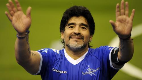 BUENOS AIRES, ARGENTINA - OCTOBER 16: Diego Maradona greets the fans during a soccer match between Argentina and Uruguay in tribute to Fernando Caceres, victim of an assault on October 16, 2010 in Buenos Aires, Argentina. Maradona organized this match to help Caceres to continue with his recovery in Cuba. (Photo by Richard Rad/LatinContent/Getty Images)