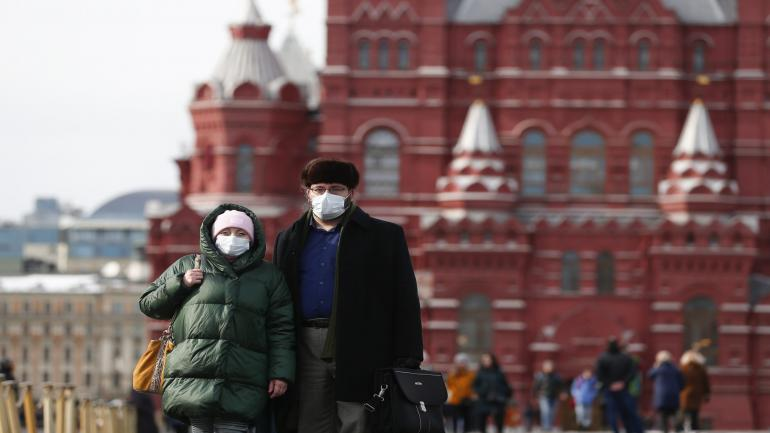 MOSCOW, RUSSIA - MARCH 16: People wear face masks as a precaution against the coronavirus (COVID-19) at Red Square in Moscow, Russia, on March 16, 2020. (Photo by Sefa Karacan/Anadolu Agency via Getty Images)