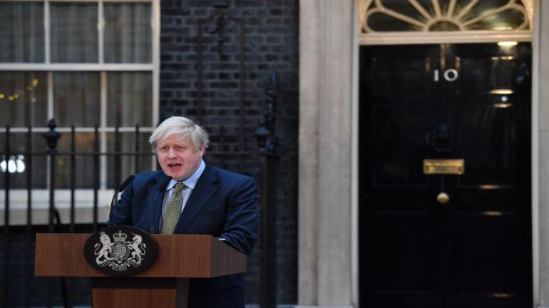 """Britain's Prime Minister Boris Johnson delivers a speech outside 10 Downing Street in central London on December 13, 2019, following his Conservative party's general election victory. - UK Prime Minister Boris Johnson proclaimed a political """"earthquake"""" Friday after his thumping election victory cleared Britain's way to finally leave the European Union after years of damaging deadlock over Brexit. (Photo by Ben STANSALL / AFP) (Photo by BEN STANSALL/AFP via Getty Images)"""