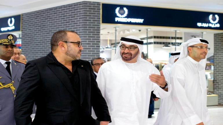 ABU DHABI, UNITED ARAB EMIRATES - October 29, 2013: HH General Sheikh Mohamed bin Zayed Al Nahyan Crown Prince of Abu Dhabi Deputy Supreme Commander of the UAE Armed Forces (C), and His Majesty King Mohammed VI of Morocco (L), tour The Galleria shopping mall at Sowwah Square on Al Maryah Island, after the opening ceremony. Seen with HE Khaldoon Khalifa Al Mubarak CEO and Managing Director Mubadala and Chairman of the Executive Affairs Authority (R). ( Ryan Carter / Crown Prince Court - Abu Dhabi ) ---