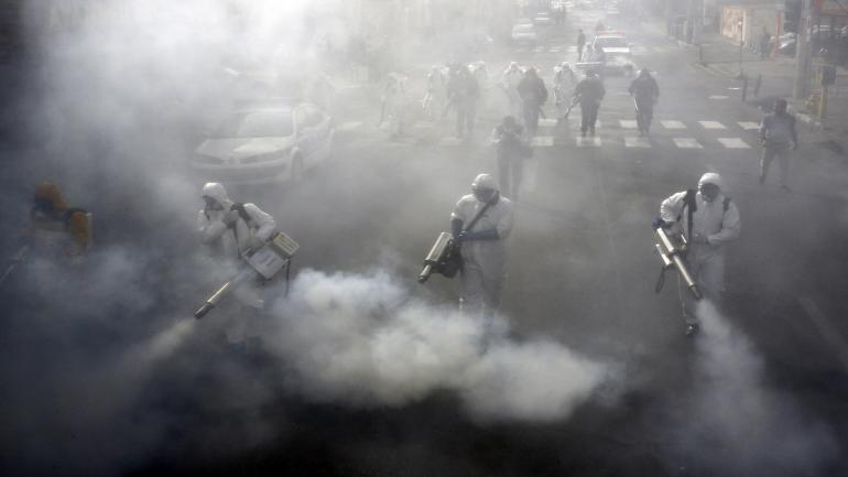 TOPSHOT - Iranian Firefighters disinfect streets in the capital Tehran in a bid to halt the wild spread of coronavirus on March 13 2020. - Iranian forces will clear the streets nationwide within 24 hours and all citizens will be checked for the new coronavirus in a bid to halt its spread, the military said. (Photo by - / AFP) (Photo by -/AFP via Getty Images)