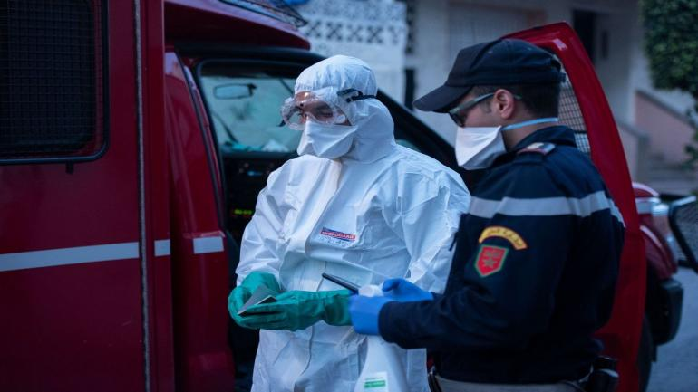 RABAT, MOROCCO - APRIL 01: A medical worker wearing protective suit prepares to transport a suspected case of the new type of coronavirus (COVID-19) in Rabat, Morocco on April 01, 2020. ( Jalal Morchidi - Anadolu Agency )